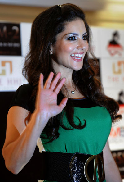 Canadian actress Sunny Leone gestures during a function to promote her