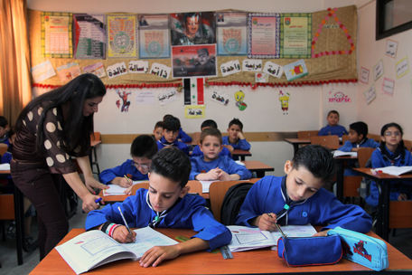 ... teacher gives a lesson at Hassan Shuaib School in Damascus, Syria.(AP