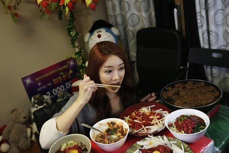 lady eating Asian
