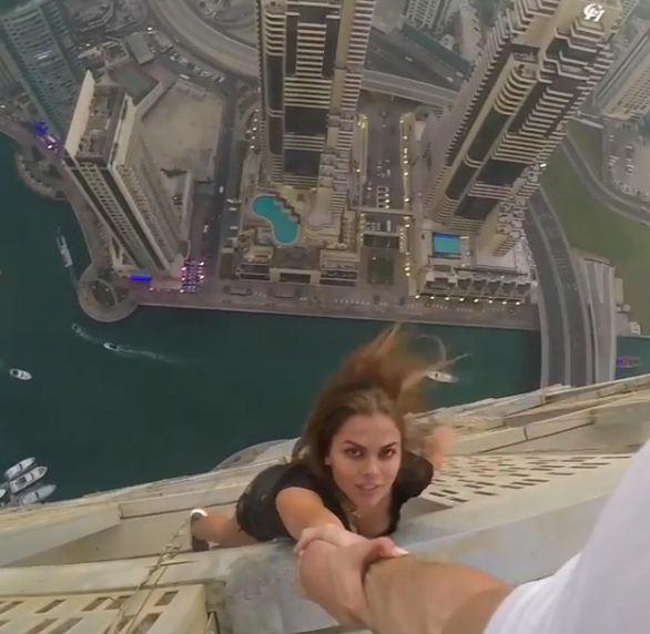 images released  model hanging   skyscraper  dubai emirates