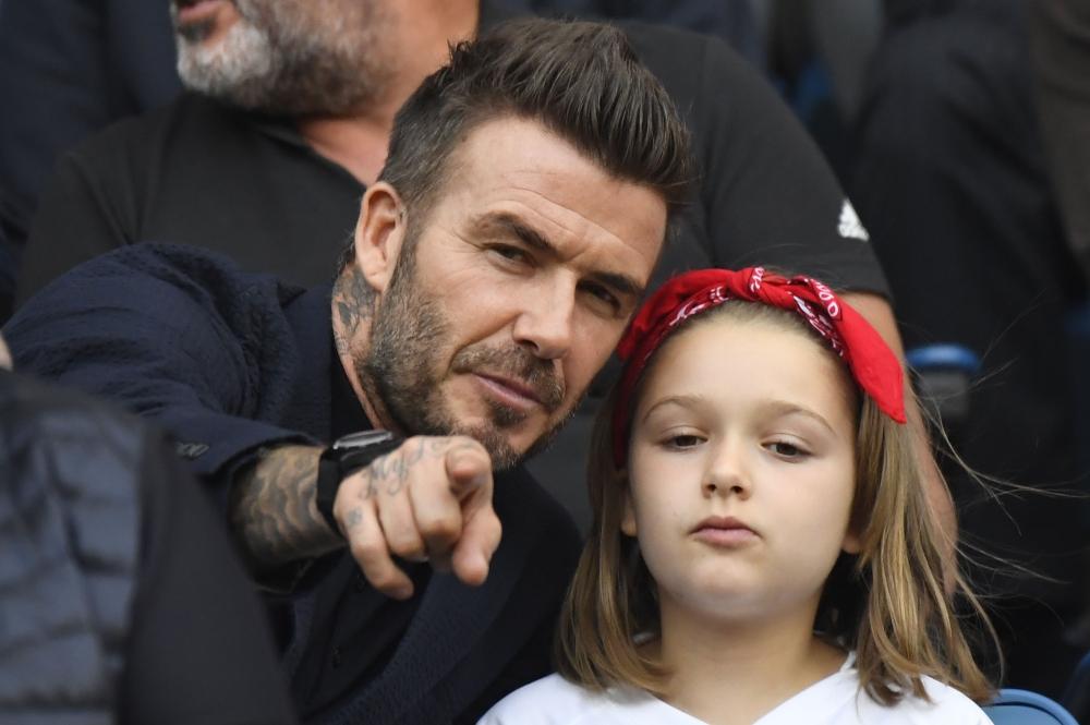 a3c7163678b1 David Beckham gestures next to his daughter Harper Beckham during the  France 2019 Women's World Cup quarter-final football match between Norway  and England.